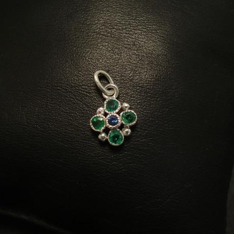 aaagrade-emeralds-33ctin4-sapphire-9ctwhite-gold-pendant-01736.jpg