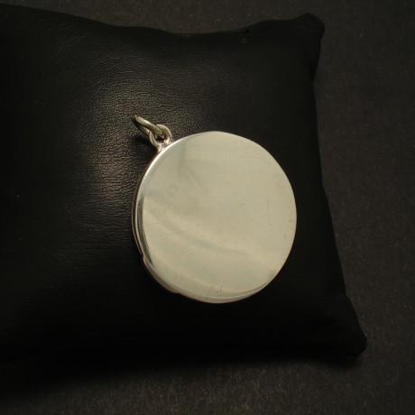 antique-plain-round-flat-silver-locket-01645.jpg