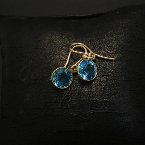 bright-blue-topaz-7mmrd-9ctgold-earrings-03027.jpg