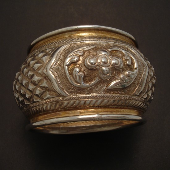 hand-embossed-solid-silver-domed-bangle-05132.jpg