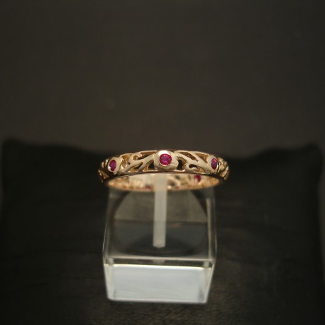 six-intense-pink-red-rubies-9ctrose-gold-scrolled-ring-04560.jpg
