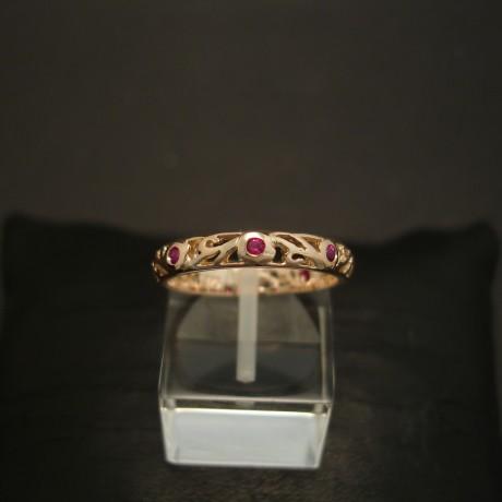 six-intense-pink-red-rubies-9ctrose-gold-scrolled-ring-04560.jpg