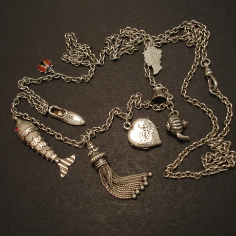 silver-charm-necklace-8antique-charms-09470.jpg