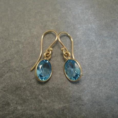 8x6mm-cut-oval-blue-topaz-9ctgold-earrings-04162.jpg