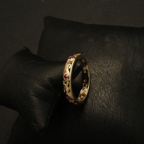 six-intense-rubies-9ctgold-scrolled-ring-02811.jpg